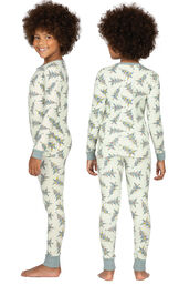 Model wearing Green Pine Tree PJ for Girls, facing away from the camera and then to the side image number 1