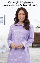 Model wearing Purrfect Flannel Nighty - Purple in a bedroom with the following copy: Purrr-fect Pajamas are a women's best friend image number 2