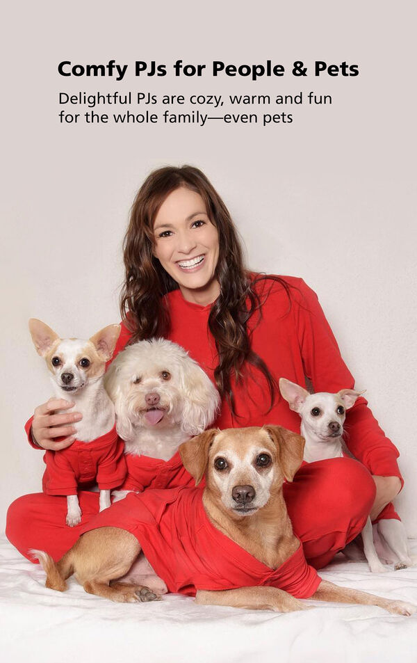 Woman and three dogs wearing red dropseat PJs with the following copy: Comfy PJs for People and Pets - Delightful PJs are cozy, warm and fun for the whole family - even pets image number 2