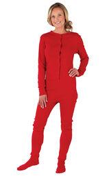 Model wearing Red Dropseat Onesie PJ for Women