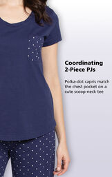 Close up of the coordinating 2-Piece PJs with the following copy: Polka-dot capris match the chest pocket on a cute scoop-neck tee image number 2