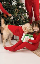 Dog wearing matching Red Thermal PJs by the Christmas Tree image number 1