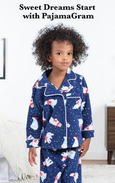 Polar Bear Fleece Toddler Pajamas by bed with the following copy: Sweet Dreams Start with PajamaGram image number 2