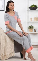 Model sitting on couch wearing Gray Cozy Capri Pajama Set  with Coral Chest Pocket image number 2