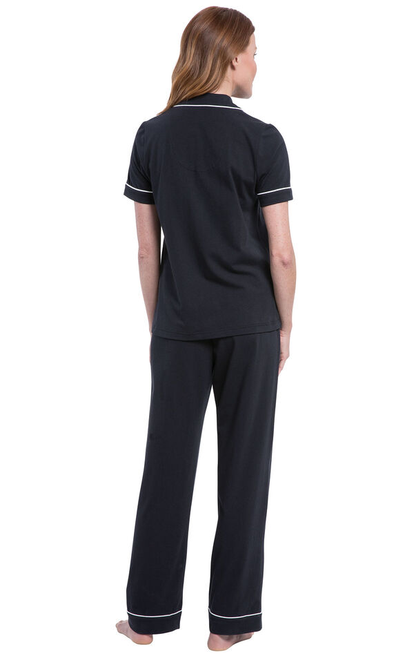 Model wearing Black Solid Short Sleeve Boyfriend PJ, facing away from the camera and then facing to the side image number 1