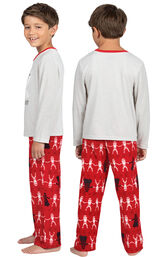Model wearing Red Star Wars PJ for Kids, facing away from the camera and then to the side image number 1