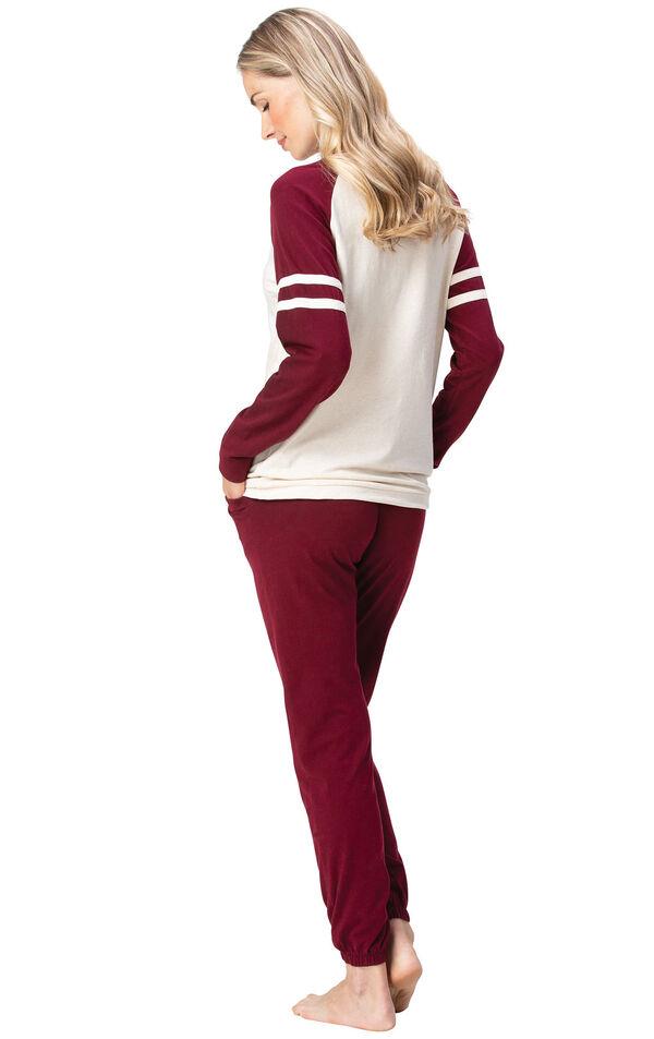 Model wearing Sunday Funday Pajamas - Burgundy, facing away from the camera image number 1
