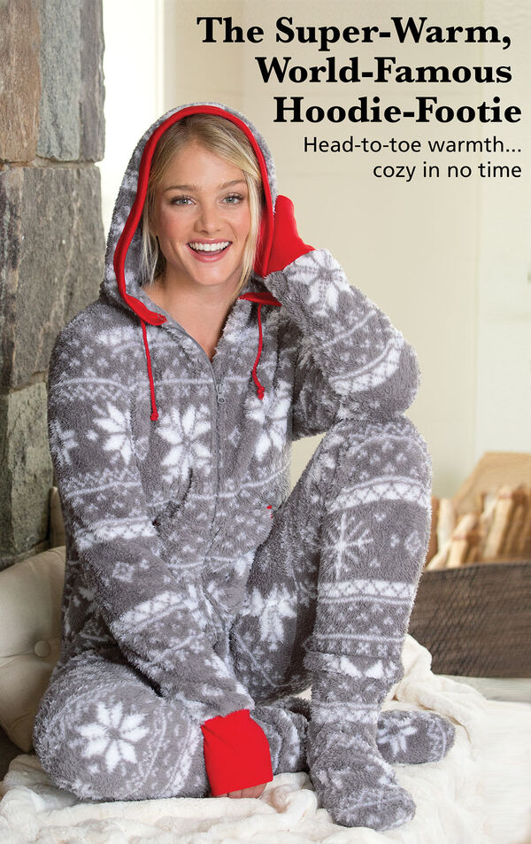 Model sitting down wearing Nordic Fleece Hoodie-Footie with the following copy: The Super-Warm, World-Famous Hoodie-Footie. Head-to-toe warmth, cozy in no time image number 2