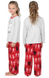 Model wearing Red Star Wars PJ for Girls, facing away from the camera and then to the side image number 1