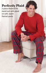 Model wearing Stewart Plaid Thermal-Top Men's Pajamas sitting on a chair with the following copy: Perfectly Plaid. 2-piece thermal PJs stand out with plaid on soft, warm flannel pants image number 2