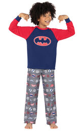 Model wearing Red and Blue Justice League PJ for Kids