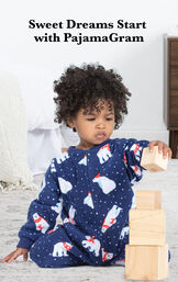 Polar Bear Fleece Infant Onesie Pajamas by bed with the following copy: Sweet Dreams Start with PajamaGram image number 2