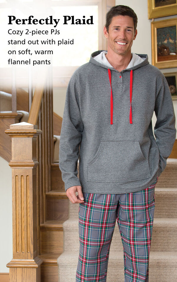 Model wearing Gray Plaid Hooded Men's Pajamas on the stairs with the following copy: Perfectly Plaid. Cozy 2-piece PJs stand out with plaid on soft, warm flannel pants image number 2