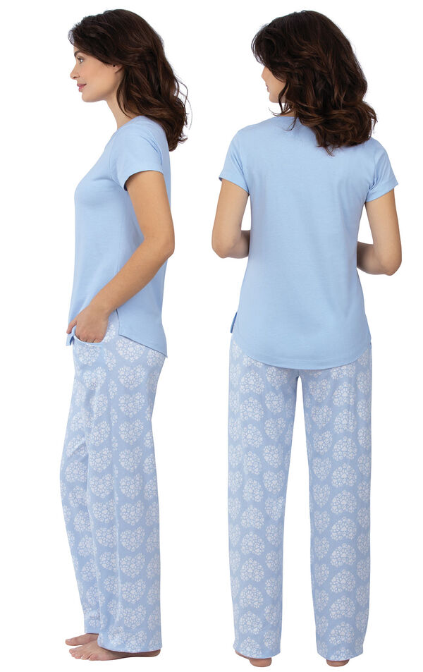 Model wearing Light Blue Paw Print Heart PJ for Women, facing away from the camera and then to the side image number 1