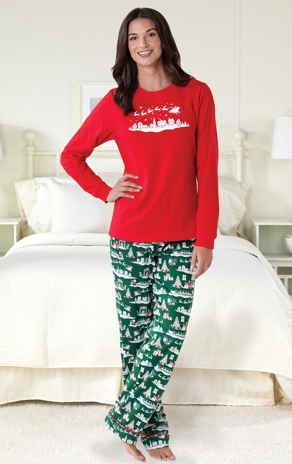Model standing by bed wearing Red and Green The Night Before Christmas Women's Pajamas image number 1