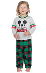 Model wearing red and green mickey mouse holiday pajamas