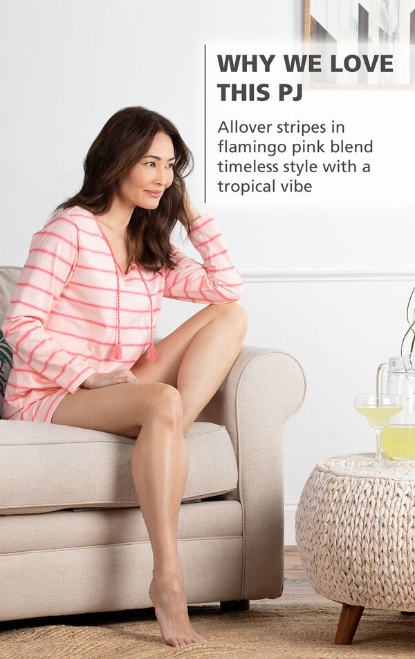 Model wearing Margaritaville Rest and Relaxation Short Set - Pink sitting on chair, with the following copy: Allover stripes in ocean blue blend timeless style with a tropical vibe image number 2