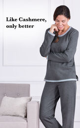 "Model wearing Charcoal World's Softest Jogger PJs by a couch with the following copy: Like Cashmere, only better"". image number 3"