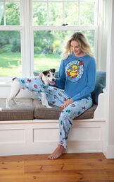 Woman and dog sitting at bay window wearing matching Grateful Dead Pajamas image number 1