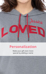 Close-up of 'Loved'' Hoodie Pajamas top personalized with a name in red on left chest image number 4