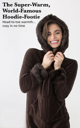 Model wearing Mink Chocolate Hoodie-Footie with the hood up with the following copy:  The Super-Warm, World-Famous Hoodie-Footie. Head-to-toe warmth, cozy in no time image number 1