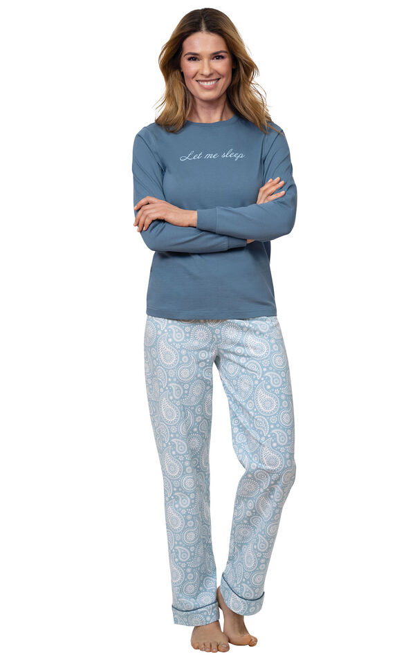 """Model wearing Blue Long-sleeve top with """"Let me sleep"""" graphic paired with Blue and White Paisley Full-length pants image number 0"""