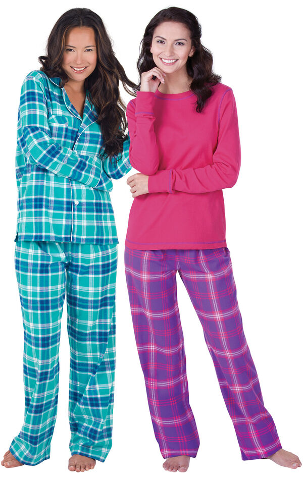 Models wearing Wintergreen Plaid Boyfriend Flannel Pajamas and Raspberry Plaid Jersey-Top Flannel Pajamas. image number 0