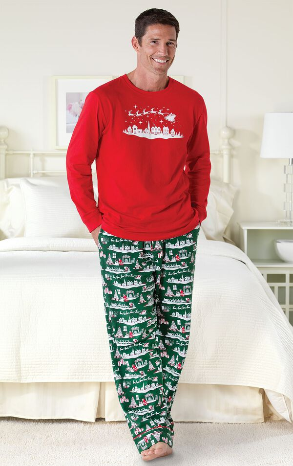 Model standing by bed wearing The Night Before Christmas Men's Pajamas image number 1