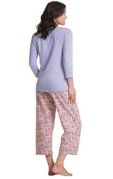 Model wearing Light Purple Floral Print PJ for Women, facing away from the camera image number 3