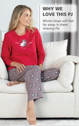 Model sitting on couch wearing Margaritaville Island Time Pajamas - Sunny Snowman print with the following copy: Winter blues will feel far away in these relaxing PJs image number 2