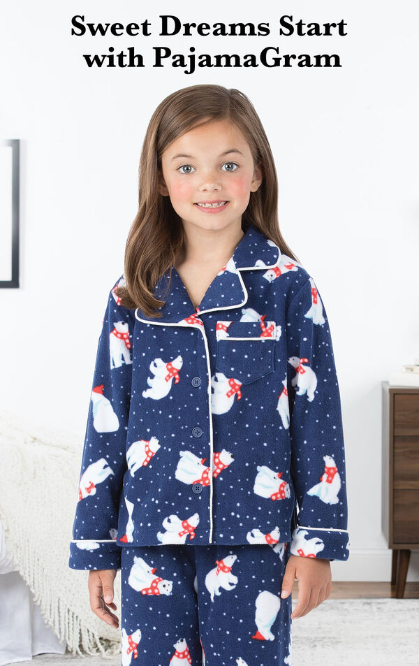 Polar Bear Fleece Girls Pajamas by bed with the following copy: Sweet Dreams Start with PajamaGram image number 2