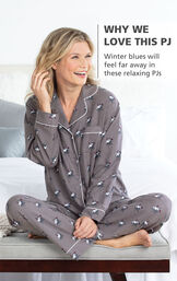Model sitting on bed wearing Gray Snowman print Margaritaville Flannel Boyfriend Pajamas with the following copy: Winter blues will feel far away in these relaxing PJs image number 2