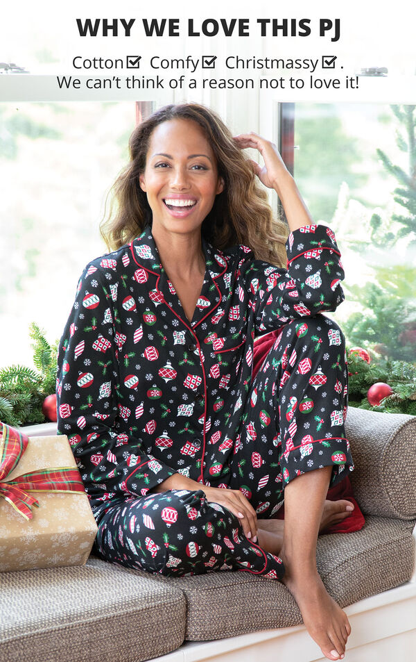 Model sitting on couch wearing Ornament Boyfriend Pajamas with the following copy: Why we Love this PJ: Cotton, Comfy, Christmassy - We can't think of a reason not to love it image number 2