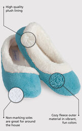Close up of the Teal World's Softest Slipper with the following copy: High quality plush lining adds warmth and a touch of glamour. Non-marking soles are great for around the house. The softest pile fleece and an extra-padded footbed image number 1