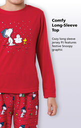 Close-up of comfy red long-sleeve top with the following copy: Cozy long sleeve jersey PJ features festive Snoopy graphic. image number 2