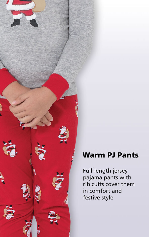 Close-up of St. Nick PJs Warm PJ Pants with the following copy: Full-length jersey pajama pants with rib cuffs cover them in comfort and festive style. image number 4