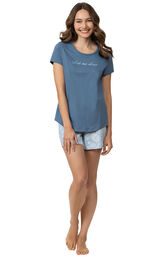 """Model wearing blue short sleeve shirt with """"let me sleep"""" text and matching blue and white paisley print shorts image number 0"""