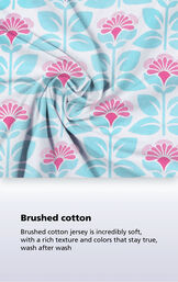 Aqua and pink fabric swatch with the following copy: Brushed cotton jersey is incredibly soft, with a rich texture and colors that stay true, wash after wash image number 4