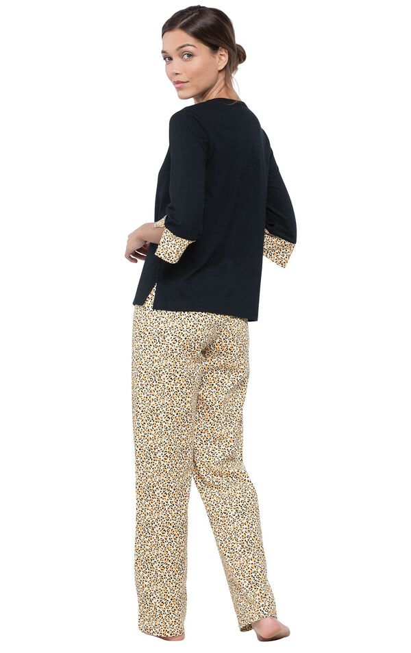 Model facing away and looking back at the camera, wearing Leopard Print Pajamas image number 2