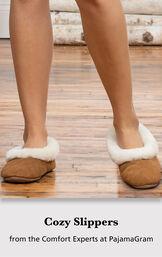 Model wearing slippers with the following copy: Cozy Slippers from the Comfort Experts at PajamaGram image number 2