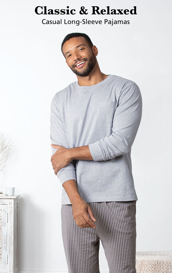 Model standing in bedroom wearing Men's Long Sleeve Striped Pajamas with the following copy: Classic and Relaxed Casual Long-Sleeve Pajamas image number 3