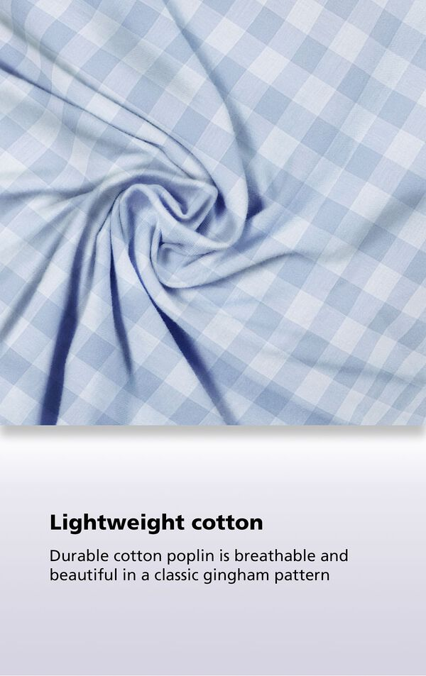 Periwinkle gingham fabric with the following copy: Durable cotton poplin is breathable and beautiful in a classic gingham pattern image number 6