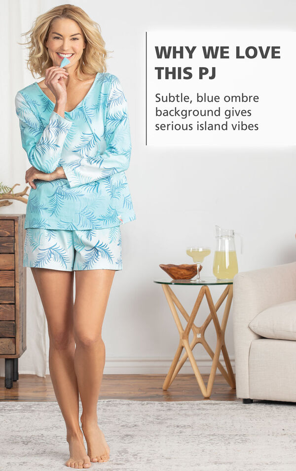 Model wearing Margaritaville Rest and Relaxation Short Set - Blue Ombre by couch with the following copy: WHY WE LOVE THIS PJ: Subtle, blue ombre background gives serious island vibes image number 2