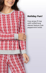 Fun Red and White Peppermint Twist Jogger Pajamas Top with the following copy: Cozy jersey PJ top with cuffed long sleeves feature cut peppermint twists image number 2