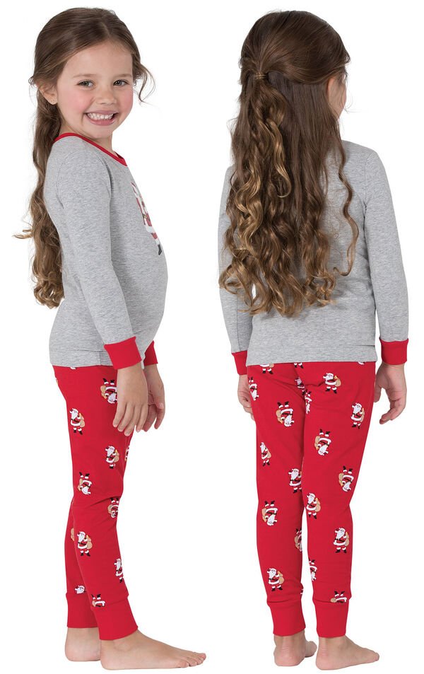 Model wearing  St. Nick Toddler Pajamas, facing away from the camera and then facing to the side image number 1