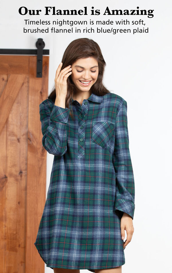 Model wearing Heritage Plaid Sleepshirt by bed with the following copy: Our Flannel is Amazing. Timeless nightgown is made with woven, yarn dyed flannel in rich blue/green plaid image number 2
