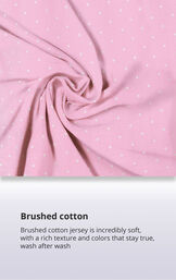 Pink Polka Dot Fabric Swatch with the following copy: Brushed cotton jersey is soft, inside and out. Machine washable cotton jersey won't fade or thin out. High-quality fabric means colors stay bright. Comfy mid-weight fabric is breathable. image number 3