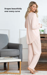 Model standing by couch wearing Pink Cloud Fine Pajamas with the following copy: Drapes beautifully over every curve image number 4