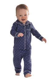 Model wearing Navy Blue and White Polka Dot Button-Front PJ for Toddlers