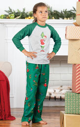 Model wearing Dr. Seuss The Grinch Girls Pajamas standing by the fireplace image number 2